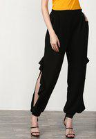 Tapered Harem Pants With Pockets Featuring Side Opening With Ruffle