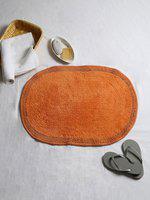 House This Orange Oval Textured Cotton Bath Rug