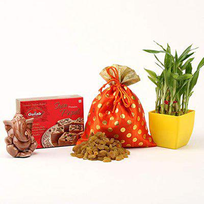 Ferns N Petals Gift Hamper of Raisin in Potli with Soan Papdi and Ganesha Idol and Two Layer Bamboo Plant in Yellow Plastic Pot for Diwali   Diwali Gift   Deepawali Gift   Home Dcor for Diwali