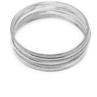 Seven Silver Coloured Bangles For That Stylish Look In Apperance.